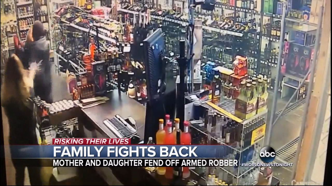 Daughter fires at robber... AND her mother.